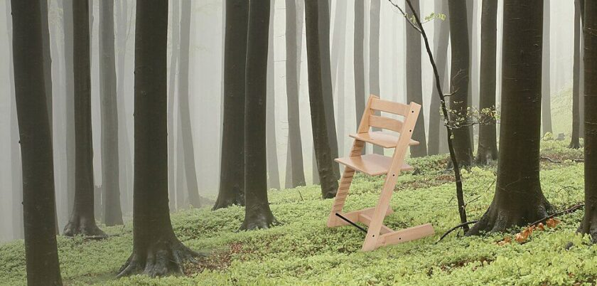 Tripp Trapp high chair sitting empty in the woods
