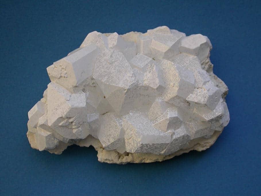 chunk of borax on a blue table