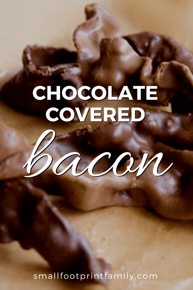 chocolate covered bacon on a wooden cutting board