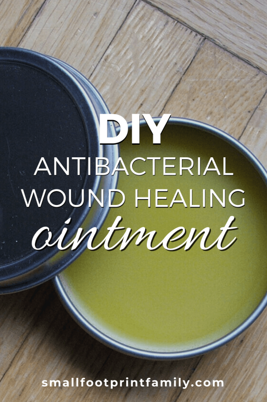 DIY antibacterial wound healing ointment in a tin on a wooden table
