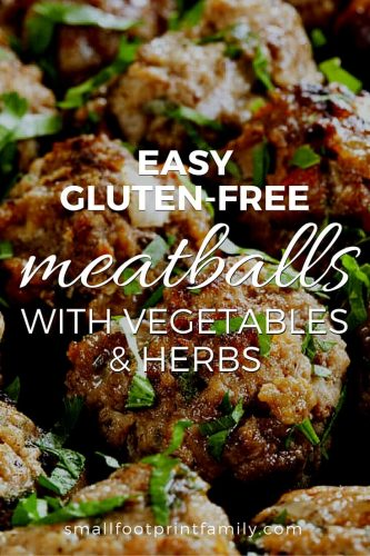 gluten free meatballs on a tray with herbs