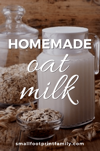 pitcher of oat milk on table with bowl of oats