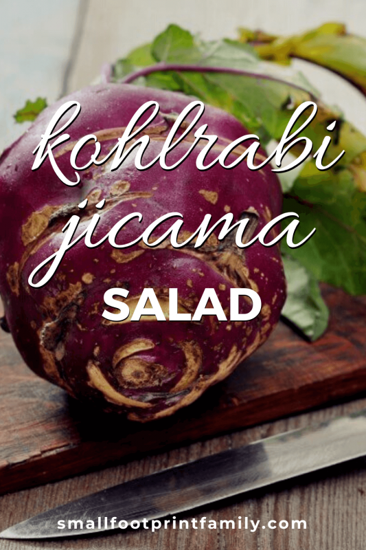 purple kohlrabi on a wooden cutting board with a knife