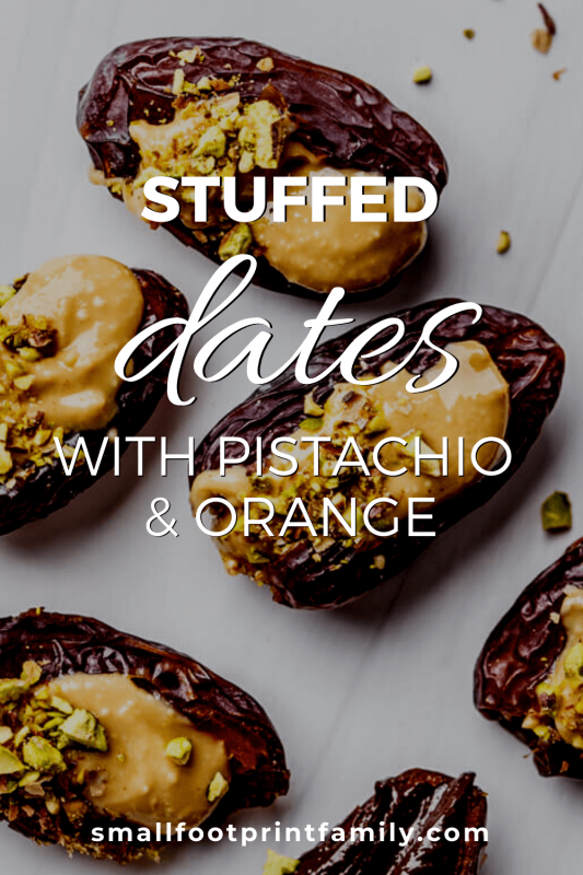 dates stuffed with pistachio and orange arranged on a white counter