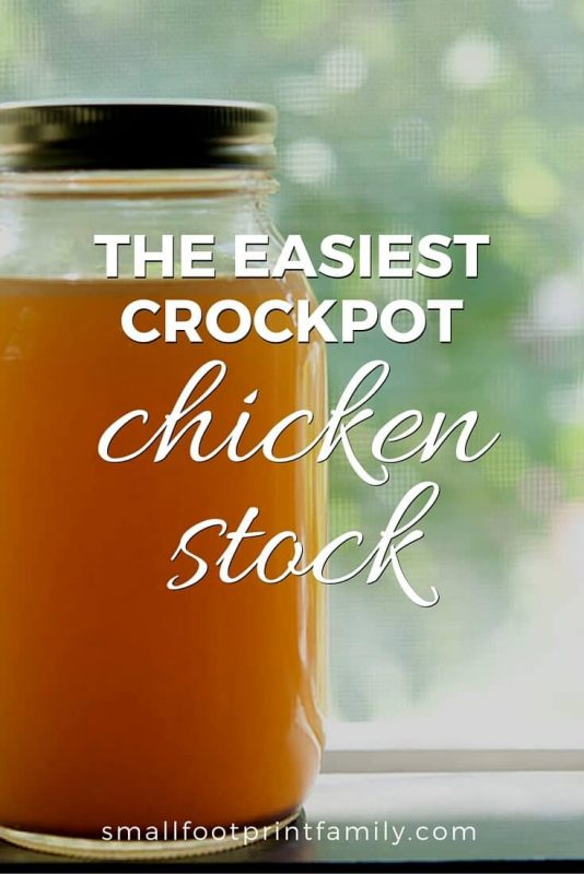 jar of crockpot chicken stock on a table by a window