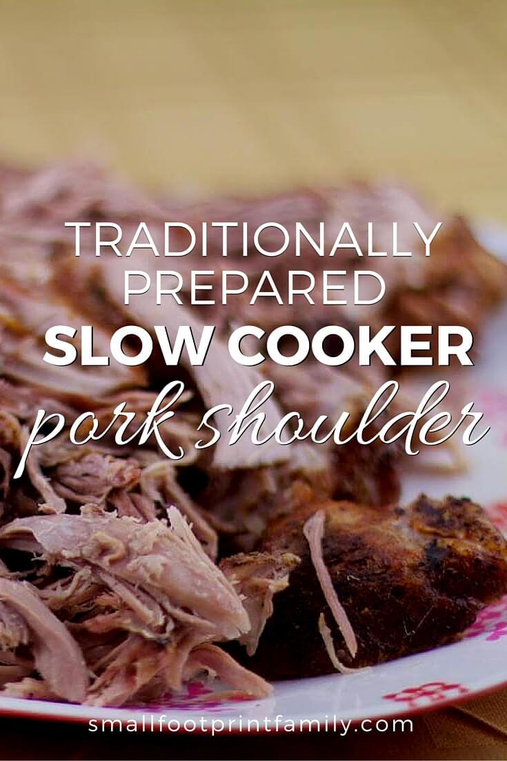 slow cooked pork shoulder on a plate on a wooden table