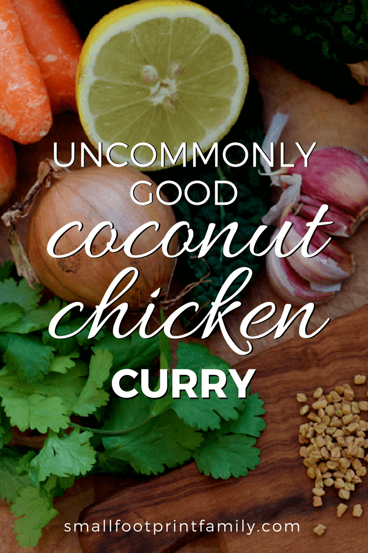 ingredients for coconut chicken curry on a wooden cutting board