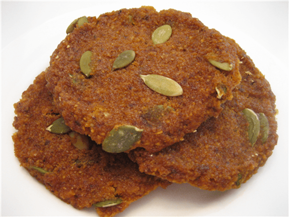 raw butternut squash cookies on a counter with pepitas on them