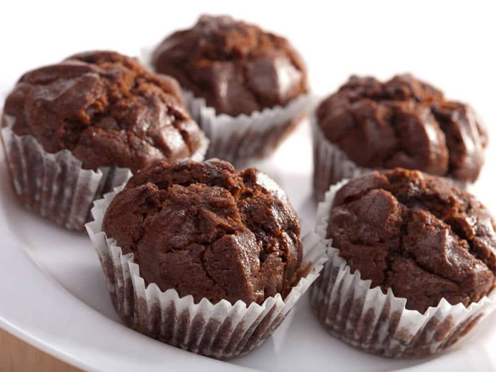 chocolate hazelnut muffins on a white plate