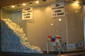pile of disposable diaper trash compared to cloth diapers