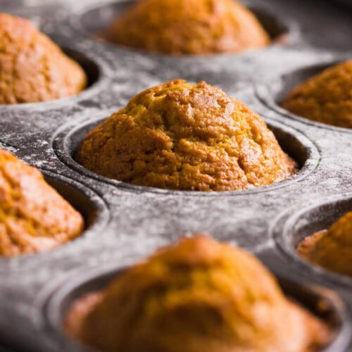 pumpkin muffins in a muffin tin
