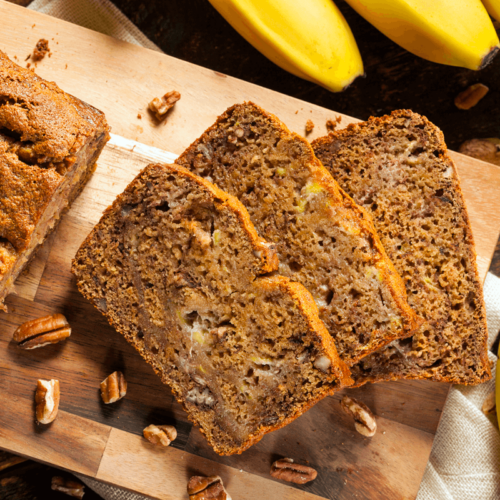 loaf of grain free banana bread sliced on a cutting board
