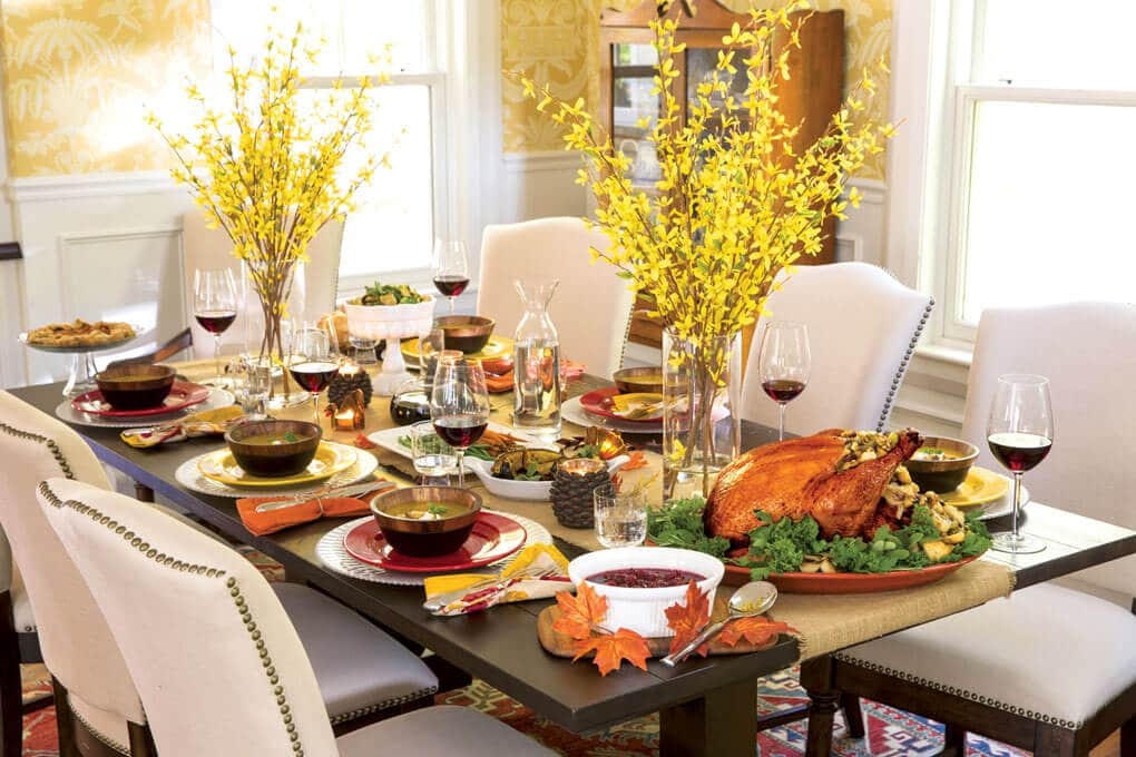 Thanksgiving table set with traditional foods