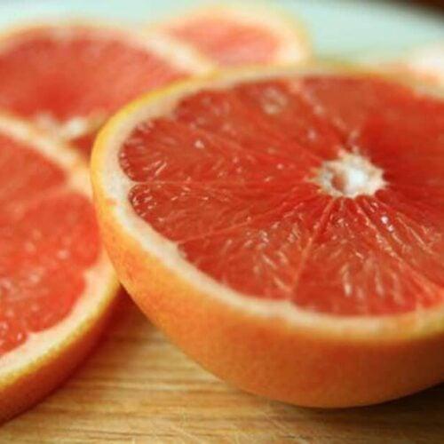 pink grapefruit halves on a countertop
