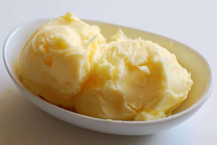 homemade butter in a white dish on a white table