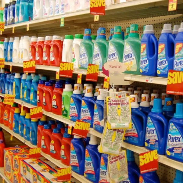 aisle of laundry detergents in supermarket