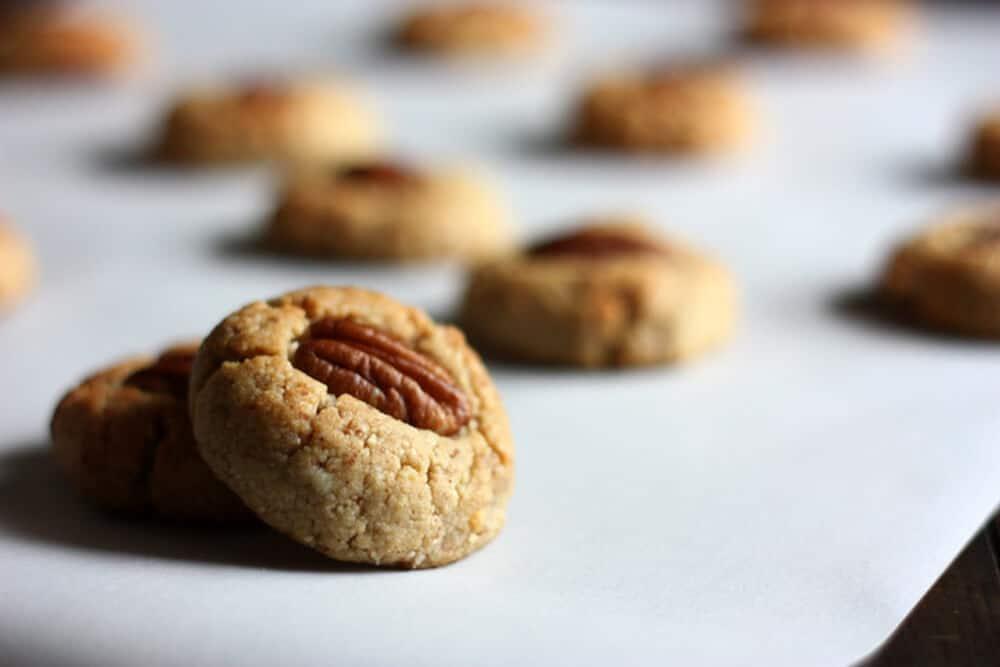 gluten free pecan sandies on a white countertop