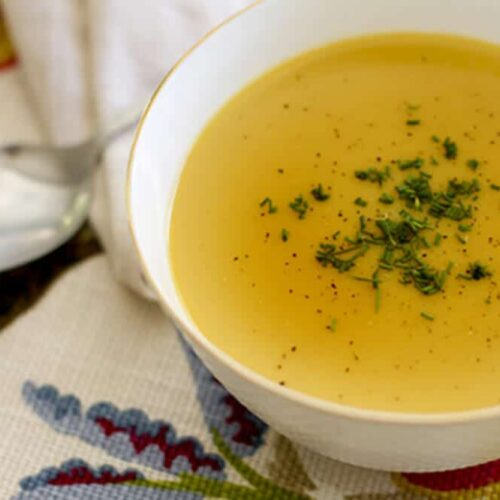butternut squash soup in a bowl with parsley