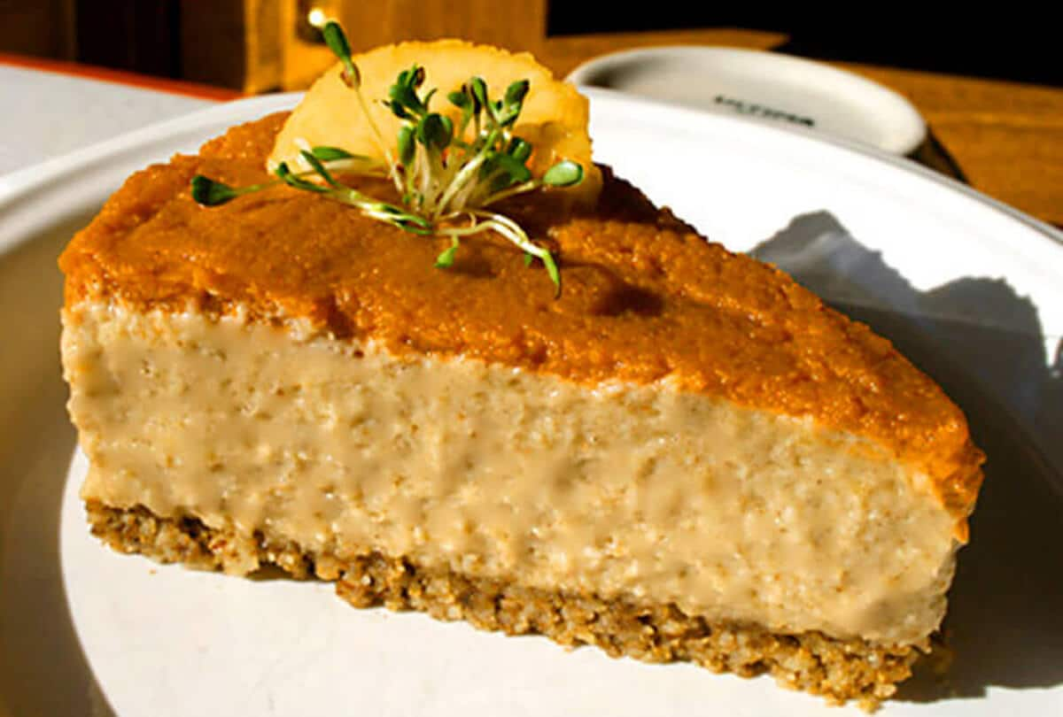 no bake vegan pumpkin cheesecake on a white plate on a table